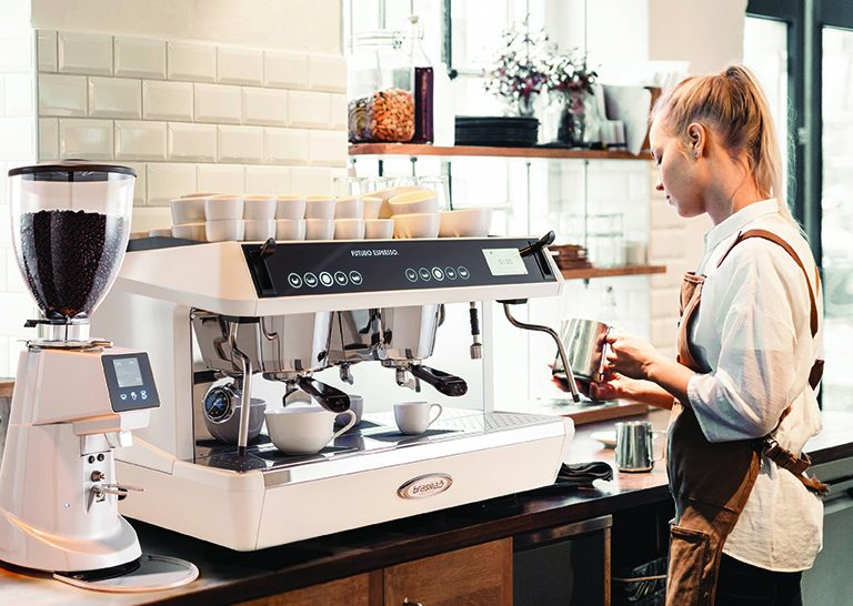Female Barista Using Brasilia Rito Coffee Machine in Cafe