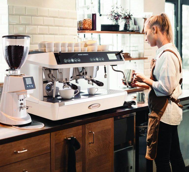Female barista using Brasilia Rito Commercial Coffee Machine